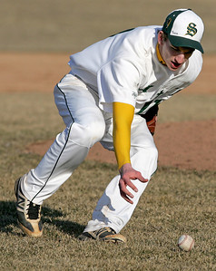 H. Rick Bamman - hbamman@shawmedia.com Crystal Lake South's pictcher Tyler Hall helped his own cause as he bare hands a Harlem grounder and throwing to first for the out in the fourth inning in the first game of the season Friday, March 29, 2013.