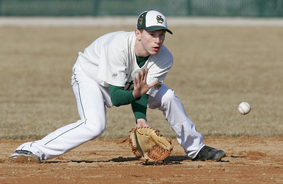 H. Rick Bamman - hbamman@shawmedia.com Crystal Lake South's Garrett Bright fields a ground ball in the first inning during the first game against Harlem of the season Friday, March 29, 2013.