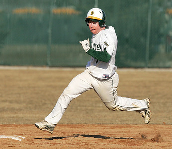 H. Rick Bamman - hbamman@shawmedia.com Crystal Lake South's Troy Bittenbender (7) rounds second base after he hit a triple in the bottom of the fourth inning Friday, March 29, 2013.