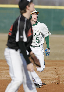 H. Rick Bamman - hbamman@shawmedia.com Crystal Lake South's Garrett Bright (5) watches a Will Fogal hit as he heads to third base in the third inning Friday, March 29, 2013.