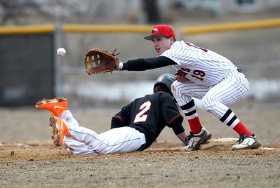 Monica Maschak - mmaschak@shawmedia.com Huntley's Kameron Sallee reaches to catch the ball in an attempt to tag out Dekalb player Jared Johnson in the first inning of the game on Wednesday, March 27, 2013. Huntley won 16-8 after the game was called for darkness.