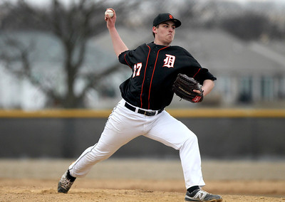 Monica Maschak - mmaschak@shawmedia.com Dekalb's John Crosby throws a pitch in the first inning of a game at Huntley High School on Wednesday, March 27, 2013. Huntley won 16-8 after the game was called for darkness.