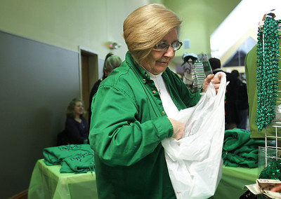 Monica Maschak - mmaschak@shawmedia.com Carole Potts bags an item from her everything-Irish line called Carole and Chip during the third annual St. Patrick's Day Festival at Springbrook Community Church.