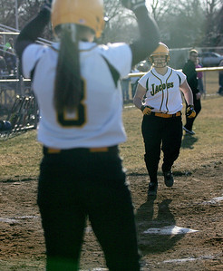 Monica Maschak - mmaschak@shawmedia.com Jacobs' Sarah Murray (8) waits to congratulate her teammate Alyssa Lach after she hit an inside-the-park home run against Larkin in Elgin on Thursday, March 28, 2013. Jacobs won 10-3.