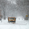A snow plow takes to the side streets in Geneva during Tuesday's snowstorm. (Sandy Bressner photo)