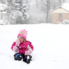 Byrdie Smith, 3, tastes fresh snow while playing with her brother, Wylder, 4, and dad, Dan, (not pictured) outside their Geneva home during Tuesday's snowstorm. (Sandy Bressner photo)