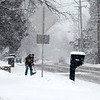 A man shovels snow during Tuesday's snowstorm. (Sandy Bressner photo)