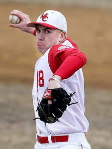 Sarah Nader - snader@shawmedia.com Marian Central's Trent Faunce pitches during Wednesday's game against McHenry at Peterson Park on March 27, 2013. McHenry won, 8-0.