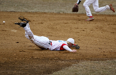 Sarah Nader - snader@shawmedia.com Marian Central's Tony Milone dives for the ball during Wednesday's game against McHenry at Peterson Park on March 27, 2013. McHenry won, 8-0.