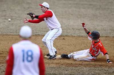 Sarah Nader - snader@shawmedia.com McHenry's Cody Freund is out by Marian Central's Edger Ross as he slides to second during the sixth inning of Wednesday's game at Peterson Park on March 27, 2013. McHenry won, 8-0.