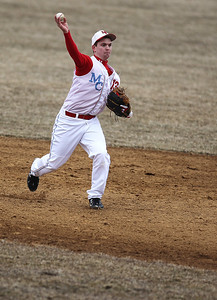 Sarah Nader - snader@shawmedia.com Marian Central's Edgar Ross throw the ball to first  during Wednesday's game against McHenry at Peterson Park on March 27, 2013. McHenry won, 8-0.