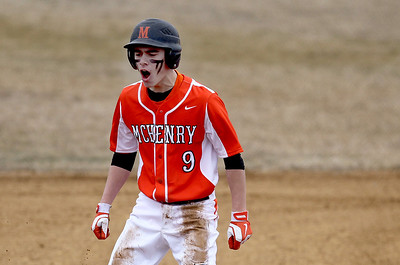 Sarah Nader - snader@shawmedia.com McHenry's Cody Freund reacts after making it to third base during Wednesday's game against Marian Central at Peterson Park on March 27, 2013. McHenry won, 8-0.