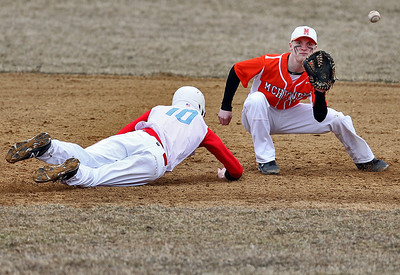 Sarah Nader - snader@shawmedia.com Marian Central's Chase Haught (left) is out by McHenry's Payton Lykins while he slides back to second after trying to steal to third in the fifth inning of Wednesday's game at Peterson Park on March 27, 2013. McHenry won, 8-0.