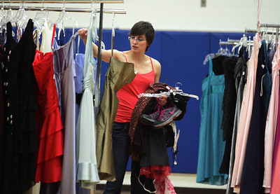 Monica Maschak - mmaschak@shawmedia.com Tina Mihm, 19, does some final browsing before purchasing a couple of special occasion dresses at the My Sister's Dress fundraiser for Big Brothers Big Sisters of McHenry County on Saturday, March 9, 2013.