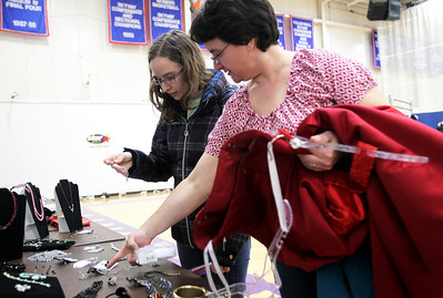 Monica Maschak - mmaschak@shawmedia.com Nicole Haley, 17, and her mom Dawn Haley look at accessories to match the dresses they picked out at the My Sister's Dress fundraiser for Big Brothers Big Sisters of McHenry County on Saturday, March 9, 2013. Gently used dresses were donated and sold for girls going to prom or other special occasions at McHenry County College.