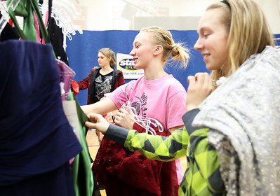 Monica Maschak - mmaschak@shawmedia.com Sparkle Lagerhausen (center), 18, and her sister Zoee Lagerhausen, 15, pick out a few dresses to try on during the My Sister's Dress fundraiser for Big Brothers Big Sisters of McHenry County. Gently used dresses were donated and sold for girls going to prom or other special occasions.