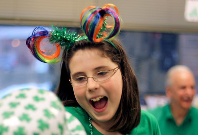 Sarah Nader - snader@shawmedia.com Grace Armstrong, 10, of Algonquin talks with a friend while attending the fifth annual Shamrock Shave at St. Margaret Mary's School in Algonquin on Saturday, March 16, 2013. More than 50 men, women and children shaved their heads to raise money for community families in need and for cancer research. The event also features a traditional irish dinner of corned beef and cabbage, music. irish dance, door prizes and raffles.