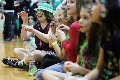 Sarah Nader - snader@shawmedia.com Marissa Cohen, 10, Itasca plays with bubbles while listening  to bag pipper while attending the fifth annual Shamrock Shave at St. Margaret Mary's School in Algonquin on Saturday, March 16, 2013. More than 50 men, women and children shaved their heads to raise money for community families in need and for cancer research. The event also features a traditional irish dinner of corned beef and cabbage, music. irish dance, door prizes and raffles.