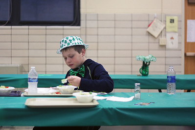 Sarah Nader - snader@shawmedia.com Joe Volenec, 9, of Algonquin eats dinner while attending the fifth annual Shamrock Shave at St. Margaret Mary's School in Algonquin on Saturday, March 16, 2013. More than 50 men, women and children shaved their heads to raise money for community families in need and for cancer research. The event also features a traditional irish dinner of corned beef and cabbage, music. irish dance, door prizes and raffles.