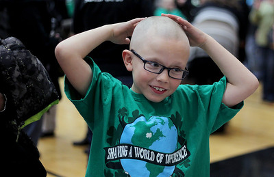 Sarah Nader - snader@shawmedia.com Tyler Juergensen, 7, of McHenry touches his head for the first time after he head shaved it while participating in the St. Baldrick's Day McHenry Community Shave at McHenry High School on Thursday, March 14, 2013.