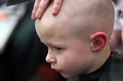 Sarah Nader - snader@shawmedia.com Braeden Juergensen, 5, of McHenry gets is head shaved while participating in the St. Baldrick's Day McHenry Community Shave at McHenry High School on Thursday, March 14, 2013.