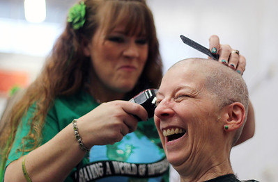 Sarah Nader - snader@shawmedia.com Debbie Gunness of McHenry reacts while having her head shaved while participating in the St. Baldrick's Day McHenry Community Shave at McHenry High School on Thursday, March 14, 2013. This is the second time Gunness has shaved her head for the foundation. This year she raised $1,600. Money raised for the event supports pediatric cancer research.