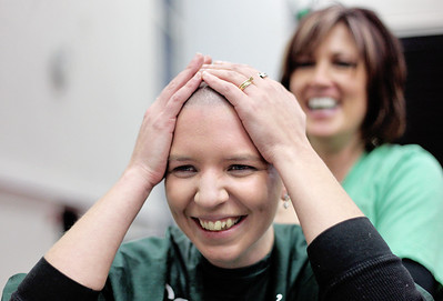 Sarah Nader - snader@shawmedia.com Angela Begley of McHenry touches her head for the first time after participating in the St. Baldrick's Day McHenry Community Shave at McHenry High School on Thursday, March 14, 2013. The fundraising event reached their goal of being number one in the world for the number of people shaving their heads at a single event for St. Baldrick's Day. Over 650 participants registered to have their heads shaved for charity.