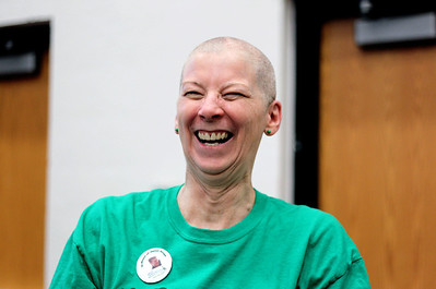 Sarah Nader - snader@shawmedia.com Debbie Gunness of McHenry reacts after having her head shaved while participating in the St. Baldrick's Day McHenry Community Shave at McHenry High School on Thursday, March 14, 2013. This is the second time Gunness has shaved her head for the foundation. This year she raised $1,600. Money raised for the event supports pediatric cancer research.