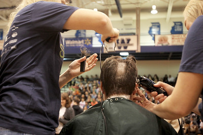 Monica Maschak - mmaschak@shawmedia.com Woodstock High School teacher John Oliveira has the first strip of hair shaved from his head in front of the whole school for the St. Baldrick's Foundation on Friday, March 15, 2013. Students and staff members went bald the day after community members shaved their heads for the foundation, raising more than $15,000.