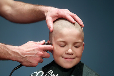 Sarah Nader - snader@shawmedia.com Keaton Asbach, 10, of Crystal Lake has his head shaved while participating in St. Baldrick's Shave-A-Thon hosted by the Kiwanis Club of Crystal Lake at the McHenry County College on Friday, March 15, 2013. This was the fourth year the Kiwanis club raised money for Childhood Cancer Research by hosting the event.
