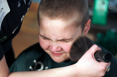 Sarah Nader - snader@shawmedia.com Nik Dzwonkiewicz, 9, of Crystal has his head shaved while participating in St. Baldrick's Shave-A-Thon hosted by the Kiwanis Club of Crystal Lake at the McHenry County College on Friday, March 15, 2013. This was the fourth year the Kiwanis club raised money for Childhood Cancer Research by hosting the event.