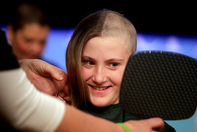 Sarah Nader - snader@shawmedia.com Lia Glauser, 11, of McHenry looks in the mirror while participating in the St. Baldrick's Shave-A-Thon hosted by the Kiwanis Club of Crystal Lake at the McHenry County College on Friday, March 15, 2013. This was the fourth year the Kiwanis club raised money for Childhood Cancer Research by hosting the event.