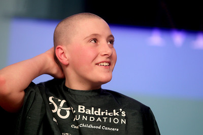 Sarah Nader - snader@shawmedia.com Lia Glauser, 11, of McHenry feels her head after having her long hair shaved at St. Baldrick's Shave-A-Thon hosted by the Kiwanis Club of Crystal Lake at the McHenry County College on Friday, March 15, 2013. This was the fourth year the Kiwanis club raised money for Childhood Cancer Research by hosting the event.