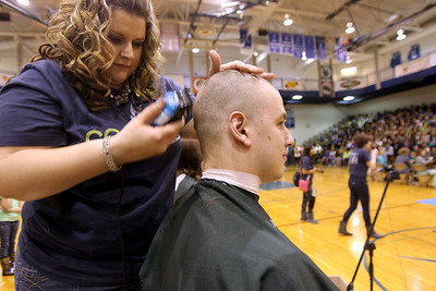 Monica Maschak - mmaschak@shawmedia.com Junior Maitiu Sexton's head is almost completely shaved as the whole school packed into the bleachers to watch the Woodstock High School St. Baldrick's event held on Friday, March 15, 2013. Students, staff and community members raised more than $15,000 for the foundation.
