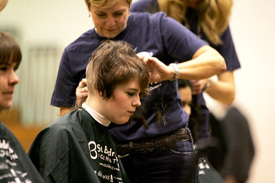 Monica Maschak - mmaschak@shawmedia.com Woodstock sophomore Nora Brown gets her head shaved in memory of her friend Hope Fuller, who died in 2010 from pediatric cancer.