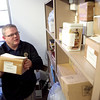 Kane County Coroner Rob Russell shows boxes of unclaimed cremated remains in the storage space used by the Coroner's office in Geneva. (Sandy Bressner photo)