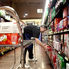 Grocery Manager Jeff Bjerklie stocks Coca-Cola at Blue Goose Supermarket in St. Charles.(Sandy Bressner photo)