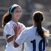 Geneva's Molly Axen is congratulated by Amanda Lulek after scoring the Vikings first goal during Saturday's game against visiting West Aurora. (Jeff Krage photo for the Kane County Chronicle)