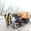 Batavia Street Division employee Joe Barkei fills potholes along Route 31 in Batavia.(Sandy Bressner photo)
