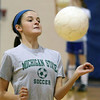 Rosary's Kaitlin Johnson practices Monday inside the school's gymnasium.<br /> (Jeff Krage photo for the Kane County Chronicle)