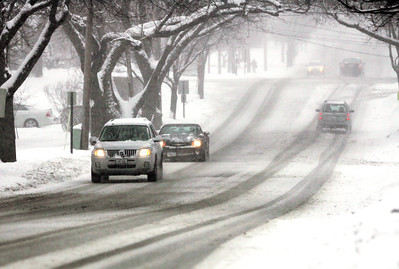 Monica Maschak - mmaschak@shawmedia.com Drivers travel cautiously on Crystal Lake Avenue in Crystal Lake as snow snow relentlessly piles up Tuesday afternoon during a snowstorm that was forecasted bring as much as 7 to 10 inches of snow throughout the Chicago area.