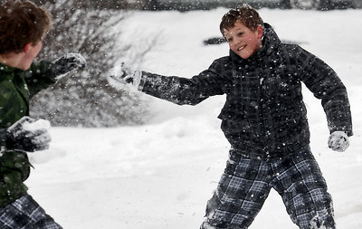 Sarah Nader - snader@shawmedia.com Carey Browne, 11, of Crystal Lake throws a snowball at his brother, Casey, while enjoying his snow day Tuesday, March 5, 2013.  The National Weather Service estimates that 7 to 10 inches could fall throughout the Chicago area.