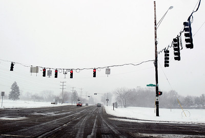 Sarah Nader - snader@shawmedia.com Traffic was light on Main Street in Crystal Lake when snow started to fall Tuesday morning March 5, 2013. Northern Illinois and northwest Indiana is under a winter storm warning until midnight and forecasters have predicted between 7 to 10 inches of snow throughout much of the Chicago region.