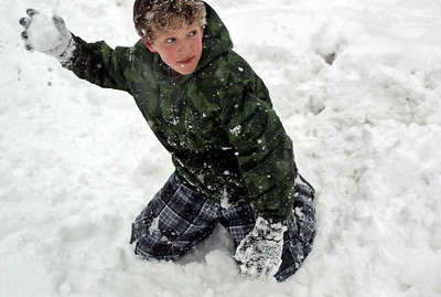 Sarah Nader - snader@shawmedia.com Casey Browne, 13, of Crystal Lake partakes in a snowball fight with neighborhood kids during his snow day Tuesday, March 5, 2013.  The National Weather Service estimates that 7 to 10 inches could fall throughout the Chicago area.