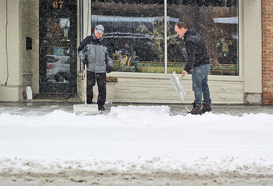Sarah Nader - snader@shawmedia.com Sidewalks get shoveled in downtown Crystal Lake on Tuesday, March 5, 2013. Northern Illinois and northwest Indiana is under a winter storm warning until midnight and forecasters have predicted between 7 to 10 inches of snow throughout much of the Chicago region.