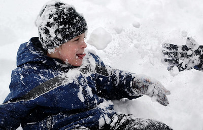 Sarah Nader - snader@shawmedia.com Will Baloun, 8, of Crystal Lake gets hit with a snowball while enjoying his snow day with neighborhood friends on Tuesday, March 5, 2013.  The National Weather Service estimates that 7 to 10 inches could fall throughout the Chicago area.