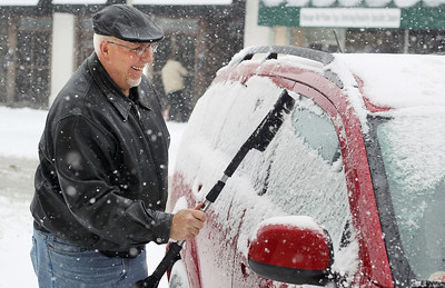 Sarah Nader - snader@shawmedia.com Dale Ankele of Crystal Lake clears off his car after enjoying breakfast at Cafe Olympic in downtown Crystal Lake on Tuesday, March 5, 2013. Northern Illinois and northwest Indiana is under a winter storm warning until midnight and forecasters have predicted between 7 to 10 inches of snow throughout much of the Chicago region.