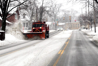 Monica Maschak - mmaschak@shawmedia.com A snow plow clears a lane on McHenry Avenue in Crystal Lake during Tuesday's snowstorm that was forecasted bring as much as 7 to 10 inches of snow throughout the Chicago area.