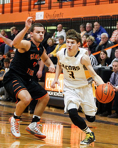 Sarah Nader- snader@shawmedia.com Crystal Lake Central's Kevin Peisker (left) guards Jacobs' Cory Boeckh while he brings the ball towards the basket during the first quarter of Monday's Class 4A Crystal Lake Central Regional on March 3, 2014. Jacobs' defeated Crystal Lake Central 46-25.