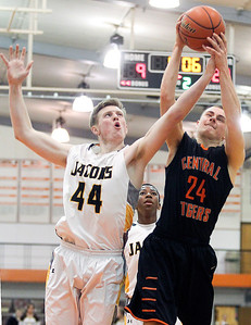 Sarah Nader- snader@shawmedia.com Jacobs' Reilly Peltier (left) and Crystal Lake Central's Jack Ortner go after the rebound during the second quarter of Monday's Class 4A Crystal Lake Central Regional on March 3, 2014. Jacobs' defeated Crystal Lake Central 46-25.